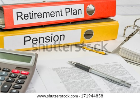 Folders with the label Retirement Plan and Pension - stock photo