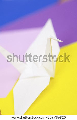 Folding A Paper Into Crane - stock photo