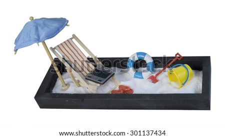 Folding Beach Chair with Laptop and Umbrella and Sand for relaxing - path included - stock photo