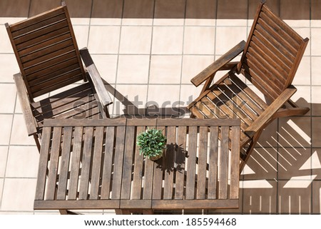 folding chair and table on a sunny day - stock photo