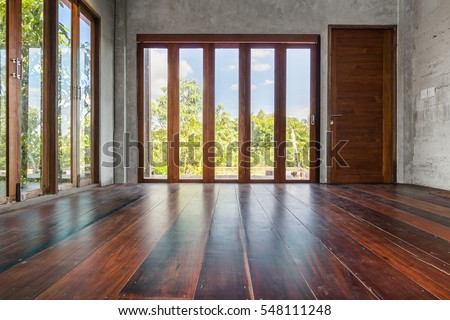 Folding doors with tall windows old wooden floor in empty living room  interior - Folding Doors Stock Images, Royalty-Free Images & Vectors
