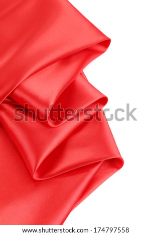 Folds of red satin. On a white background.