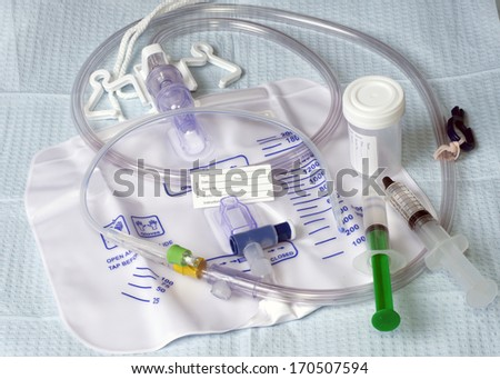Foley catheter with drainage bag and patient name tag. - stock photo