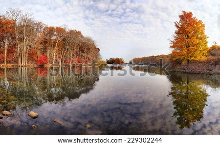 Foliage reflection in the water. Panorama,. Fall, autumn, travel, boating, hunting and outdoors concept. Shot in North Shore Long Island, New York - stock photo