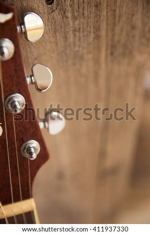 folk guitar, unplugged music instrument with wood background.