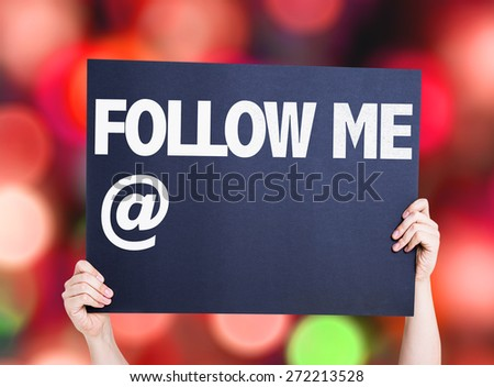 Follow Me with a copy space card with bokeh background - stock photo