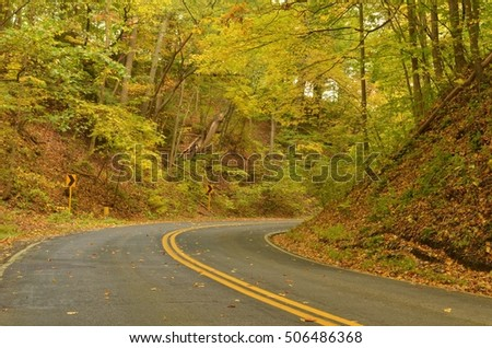 Follow the Curve in the road in Autumn