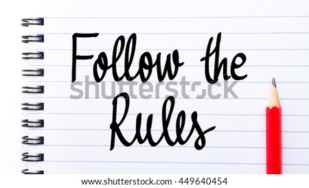 Follow The Rules written on notebook page with red pencil on the right