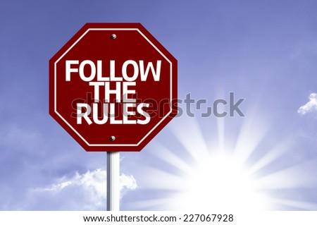 Follow the Rules written on red road sign with a sky on background - stock photo