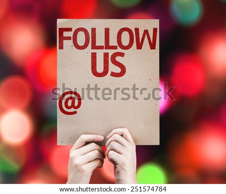 Follow Us and a Copy Space to Put Your Profile card with colorful background with defocused lights - stock photo