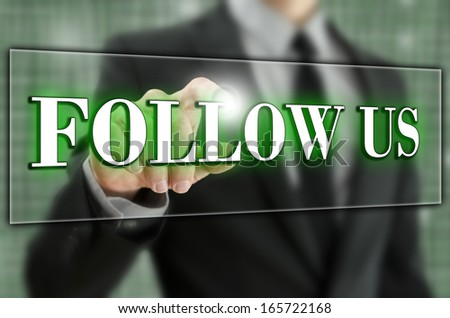 Follow us button on virtual screen. - stock photo