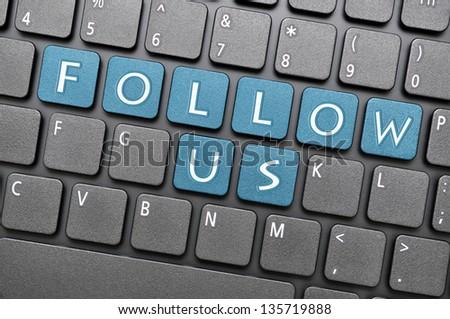 Follow us on keyboard - stock photo