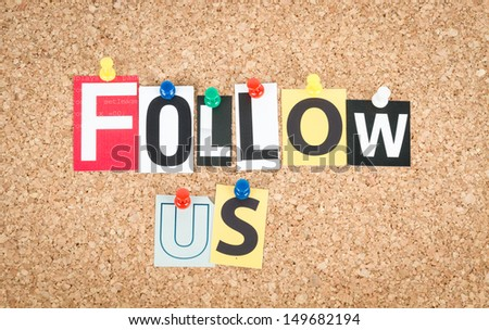 Follow Us, pinned on cork bulletin board. - stock photo