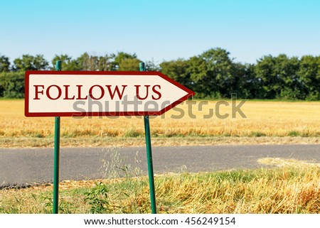 Follow us text on pointer on field background Share Follower Join us Concept