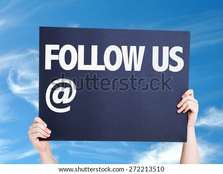 Follow Us with a copy space card with sky background - stock photo