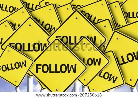 Follow written on multiple road sign - stock photo