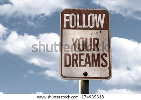 Follow your dreams road sign on a beautiful day - stock photo