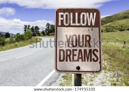 Follow your dreams road sign on the road - stock photo