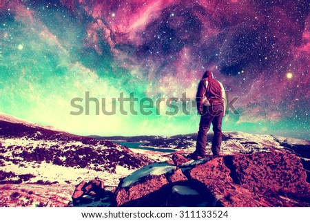 Follow your dreams, silhouette of man and many stars- elements of this image are furnished by NASA