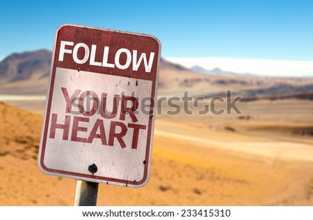 Follow Your Heart sign with a desert background - stock photo