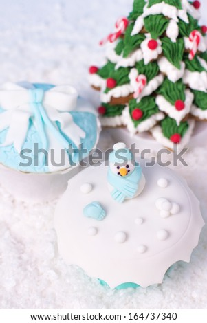 fondant cupcakes and frosted gingerbread stacked like christmas tree - stock photo