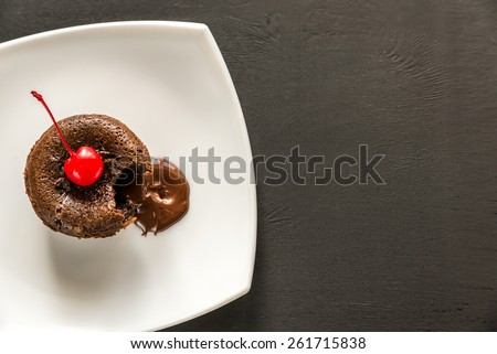 Fondant decorated with cocktail cherry - stock photo