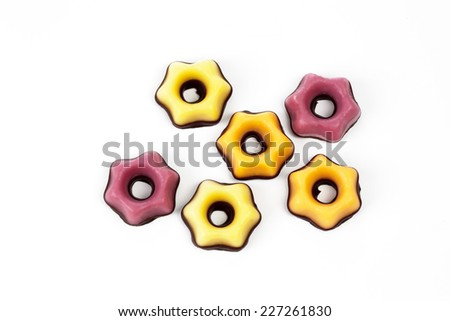 Fondant pastries on white background - stock photo