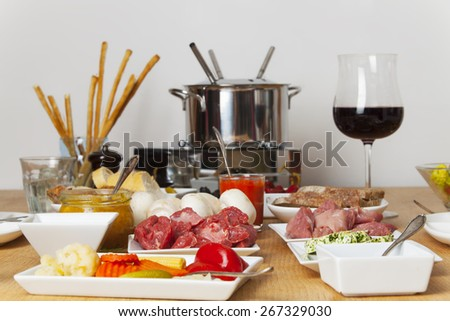 fondue set on a table - stock photo