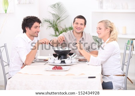 Fondue with friends - stock photo