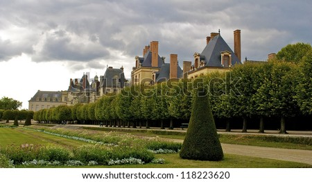 FONTAINEBLEAU, FRANCE: Palace of Fontainebleau is one of the largest French royal castles. The palace is arranged around a series of courtyards. Forest of Fontainebleau is a former royal hunting park. - stock photo