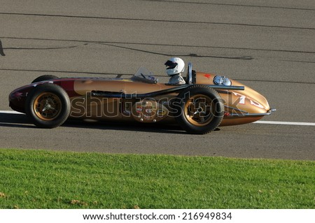 FONTANA - AUGUST 30:  Vintage race cars are driven during the pre-race festivities at the IndyCar World Championships at the AutoClub Speedway on August 30, 2014 in Fontana, CA.
