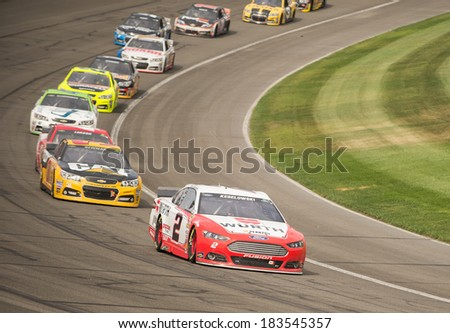 FONTANA, CA - MAR 23: Brad Keselowski 2) leads in to turn 3 at the Nascar Sprint Cup Auto Club 400 race at Auto Club Speedway in Fontana, CA on March 23, 2014