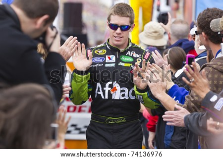 FONTANA, CA - MAR 27: Carl Edwards (99) walks through the line of fans before the start of the Auto Club 400 NASCAR Sprint Cup race at the Auto Club Speedway in Fontana, CA on Mar 27, 2011.
