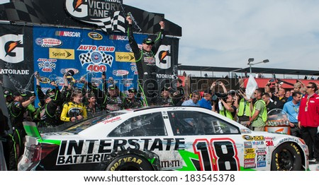 FONTANA, CA - MAR 23:Kyle Busch celebrates the win at the Nascar Sprint Cup Auto Club 400 race at Auto Club Speedway in Fontana, CA on March 23, 2014 - stock photo
