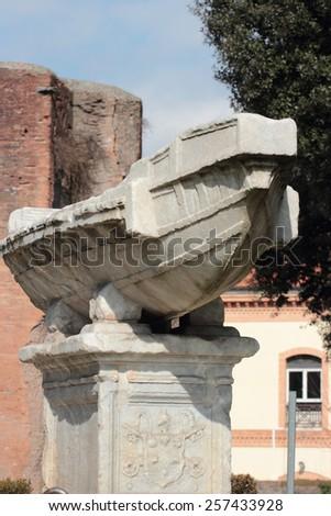 Fontana della Navicella ancient roman sculpture in front of the church of Santa Maria in Domnica , Rome, Italy - stock photo