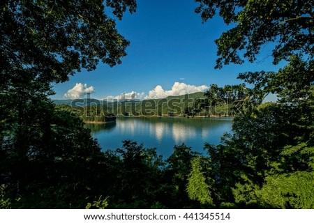 Fontana Lake From the Trees Appalachian Trail, Appalachian Mountains, North Carolina - stock photo