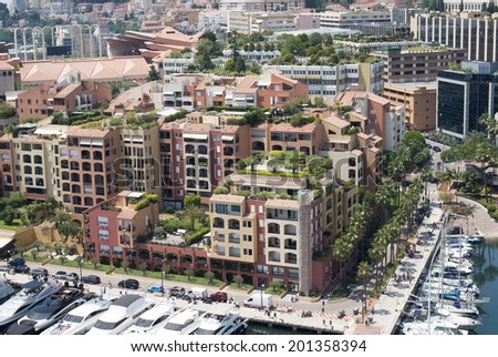 FONTVIEILLE, MONACO - JUNE 12, 2014: Modern buildings in Fontvieille - newest of the four traditional quarters in the Principality of Monaco, constructed almost entirely on artificially reclaimed land
