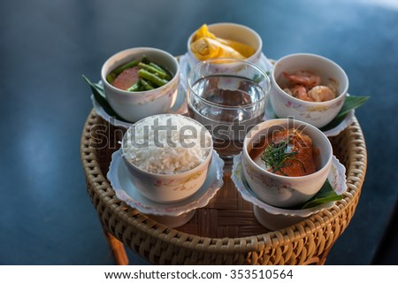 Food and cooked rice and desserts in ceramic bowl, The merit of Buddhist ceremony - stock photo