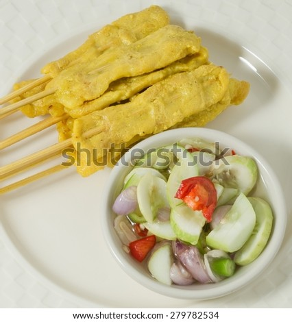 Food and Cuisine, A Dish of Grilled Pork Satay on Bamboo Skewer Served with Cucumber Salad. - stock photo