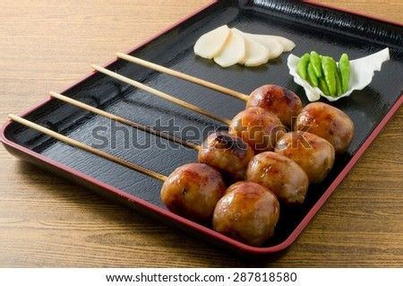 Food and Cuisine, A Tray of Thai Grilled Sausages on Wooden Skewer Served with Slice Ginger, Cabbage and Chili Pepper. - stock photo