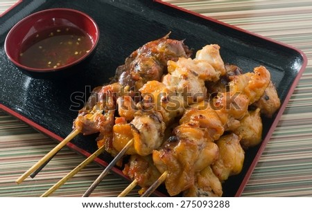 Food and Cuisine, Chicken Grilled or Barbecue Chicken on Skewer Served with Spicy Sauce. - stock photo