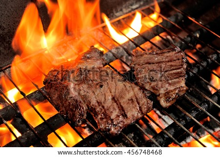 Food and Cuisine : Grilled steak on flame