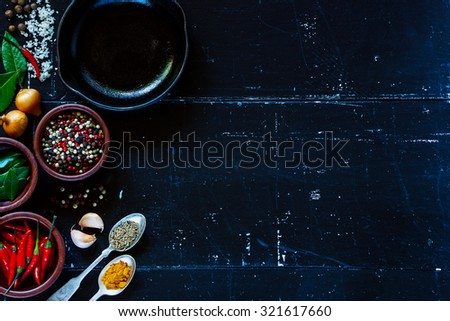 Food and cuisine ingredients on dark vintage texture. Herbs and spices selection. Top view. Background with space for text. - stock photo