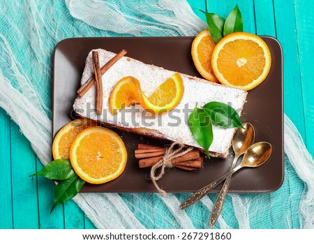 Food and drink, still life concept. Home made orange cake on a wooden table. Selective focus, top view - stock photo
