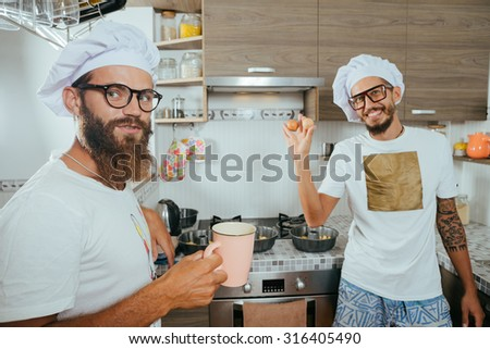 food and people concept - happy male chef cook baking over kitchen background - stock photo