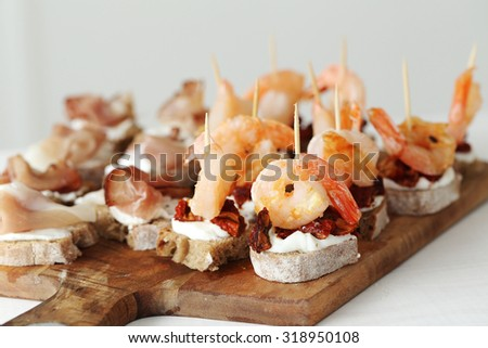 Food, appetizer. Delicious snacks on the table - stock photo