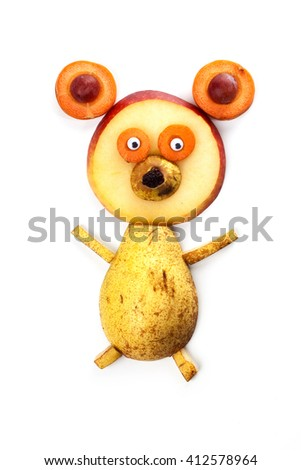 Food art creative concepts. Funny bear made of pear, apple, carrots, grapes and raisin isolated on white background. - stock photo