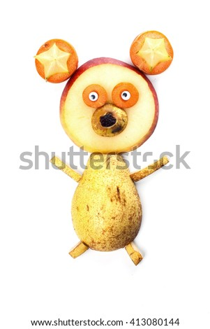 Food art creative concepts. Funny bear made of pear, apple, carrots, star fruits and raisin isolated on white background - stock photo
