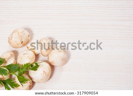 Food background of fresh mushrooms at the wooden board with copy space - stock photo