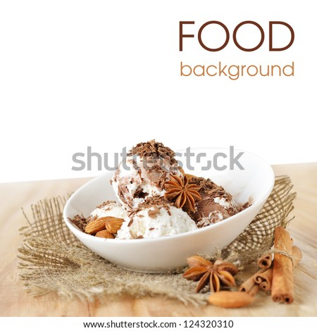 Food background. Scoops of ice cream with nuts and chocolate - stock photo